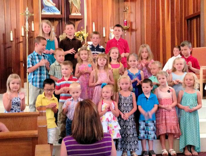 Childen standing at altar